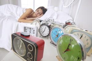 Woman Sleeping Beside Alarm Clocks