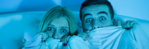 Halloween - scared couple hiding