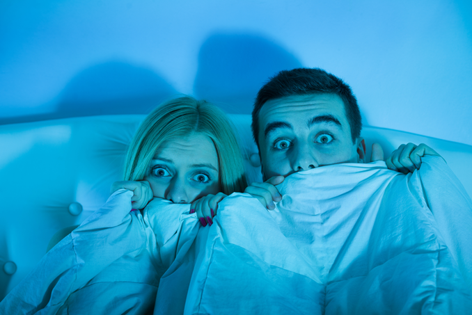 Halloween - scared couple hiding